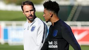 Gareth Southgate (left) has warned his England players they risk losing the connection they have with supporters (Martin Rickett/PA)