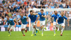 Manchester City celebrate their victory (Adam Davy/PA)