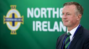 Michael O'Neill has issues over teenage players being forced to make career-binding decisions.