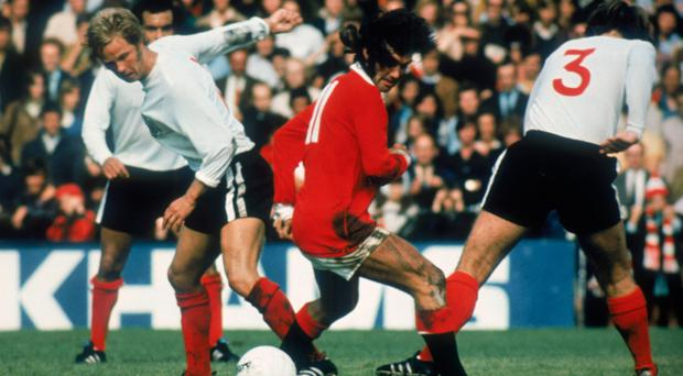 Silky skills: George Best weaves his magic during his Manchester United days