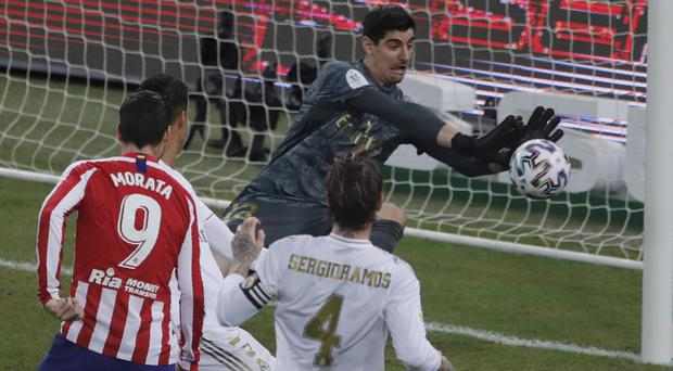 Thibaut Courtois was the hero in Real Madrid's Super Cup victory over Atletico (Amr Nabil/AP)
