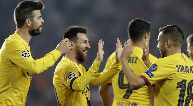 Lionel Messi (second left) was congratulated by his Barcelona team-mates after scoring against Slavia Prague (Petr David Josek/AP)