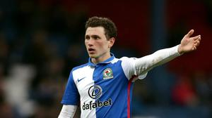 Corry Evans had a goal and an assist on his return for Blackburn (Clint Hughes/PA)