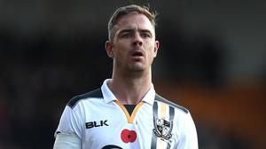 Tom Pope has been charged with an aggravated breach of FA rules on social media (David Davies/PA)