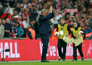 Roy Hodgson applauds England's fans after sealing World Cup qualification (David Davies/PA)