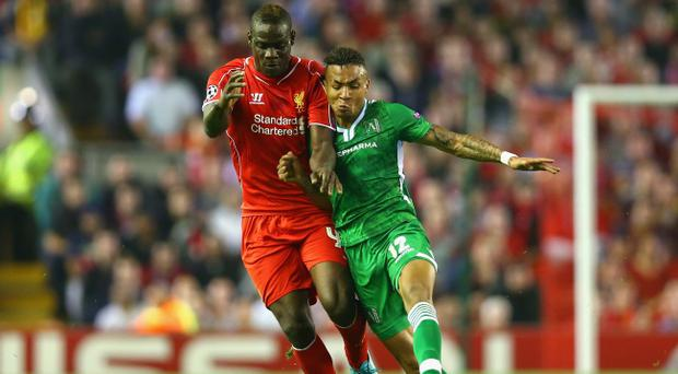 Anicet Abel of Ludogorets (right) battles with Mario Balotelli, then of Liverpool