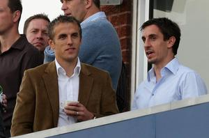 Phil Neville and Gary Neville played together for Manchester United and England (Dave Thompson/PA)