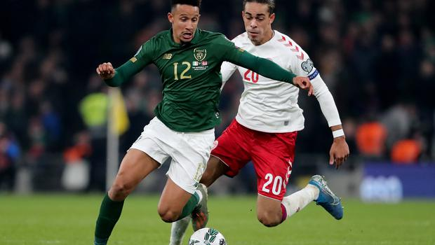 Republic of Ireland's Callum Robinson (left) and Denmark's Yussuf Poulsen (right) battle for the ball during the UEFA Euro 2020 Qualifying match at the Aviva Stadium, Dublin (Niall Carson/PA)