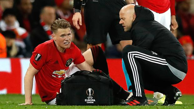 Manchester United midfielder Scott McTominay, pictured receiving treatment for an injury during a Europa League clash with Partizan Belgrade, will miss the trip to Sheffield United (Martin Rickett/PA Images).