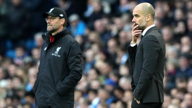 Pep Guardiola, right, said he would join Jurgen Klopp in preventing players from travelling if it would require quarantine (Martin Rickett/PA)