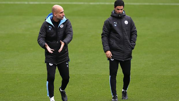 Pep Guardiola, left, rates Mikel Arteta, right, highly (Barrington Coombs/PA)