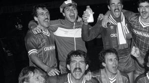 Michael Robinson (back row, second left) pictured celebrating a League Cup win with Liverpool team-mates, has died at the age of 61.