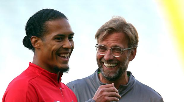 Virgil Van Dijk, left, and Jurgen Klopp have been given personal recognition (Nigel French/PA)