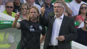 Craig Levein (right) and assistant Austin Macphee (left) have left Hearts (Jeff Holmes/PA)