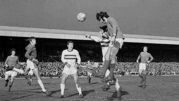 Manchester United's George Best heads home the first of his six goals in an 8-2 FA Cup fifth round win at Northampton (PA)