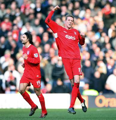 Peter Crouch (right) celebrates scoring an FA Cup winner against United at Anfield in 2006 (Martin Rickett/PA)