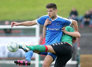 Tight tussle: Ballinamallard's Adam Lecky holds off Glentoran's Ross Redman
