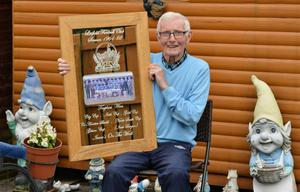 Reflective mood: Isaac Andrews with a memento of the seven trophy season
