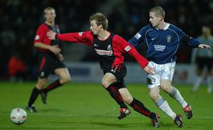 Wade Elliott in action for his first League club Bournemouth.