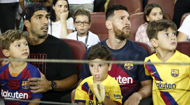 Lionel Messi, right, and Luis Suarez both remain out for Barcelona (Joan Monfort/AP)