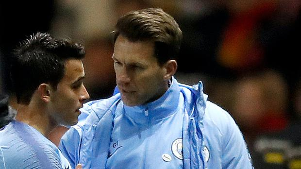 Manchester City's Eric Garcia is consoled by manager Gareth Taylor (right) after leaving the game with an injury during the FA Youth Cup final at The City Academy Stadium, Manchester.