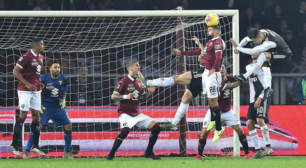 Torino's Tomas Rincon, second right, heads off target during the Turin derby (Alessandro Di Marco/AP)