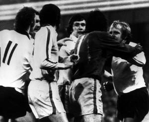 Hunter and Derby's Francis Lee are separated by Leeds goalkeeper David Harvey (dark shirt) after they had exchanged blows (PA)
