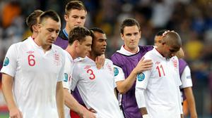 England's Ashley Cole and Ashley Young are consoled after missing in the shoot-out (Anthony Devlin/PA)