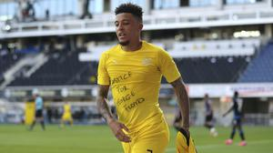 Jadon Sancho made a political message after scoring his first (Lars Baron/Pool via AP)