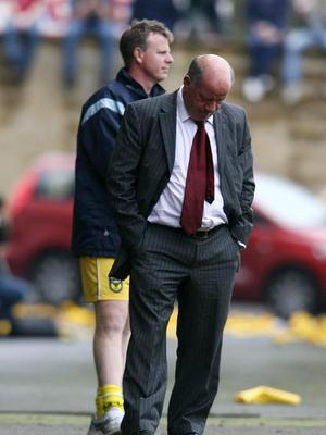 Jim Smith hangs his head as Oxford side are relegated from the Football League with a last-day home defeat to Leyton Orient at the Kassam Stadium in 2006.