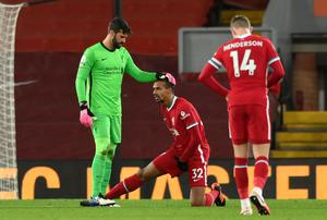 Liverpool's Joel Matip (centre) will be assessed in training before Jurgen Klopp decides if he is fit enough to return from a groin problem against Manchester United.