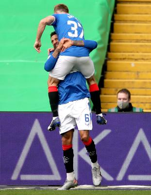 Rangers' Connor Goldson (bottom) celebrates scoring his side's first goal at Celtic Park (Jane Barlow/PA)