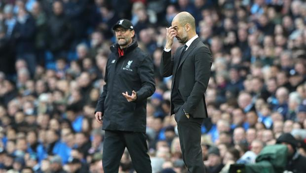 Liverpool manager Jurgen Klopp (left) and Manchester City manager Pep Guardiola ride the touchline during a Premier League match. Both were inducted into the League Managers' Association Hall of Fame on Thursday (Martin Rickett/PA)
