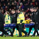 Shkodran Mustafi was stretchered off the field of play with an ankle injury (John Walton/PA)