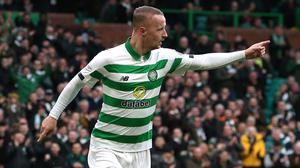 Celtic's Leigh Griffiths scores the first of his hat-trick against St Mirren (Andrew Milligan/PA)