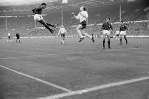 Stiles jumps with Eusebio during England's 1966 World Cup semi-final win over Portugal (PA Archive)