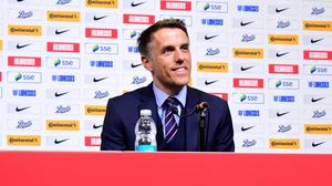 Phil Neville looks set to leave his role next year (Ian West/PA)