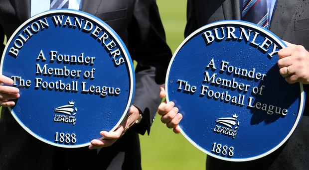 A plaque is presented to then-Bolton chairman Phil Gartside, left, in 2013 to commemorate the club as one of the Football League's founder members (Dave Thompson/PA)