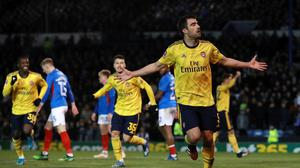 Arsenal's Sokratis Papastathopoulos, right, was one of two players to score against Portsmouth (Adam Davy/PA)