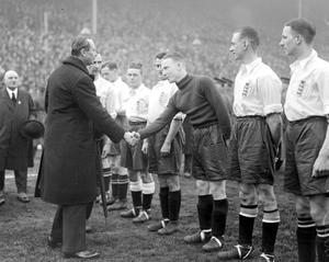 The Duke of Gloucester shakes hands with Harry Hibbs before England v Scotland at Wembley in 1930 (PA)