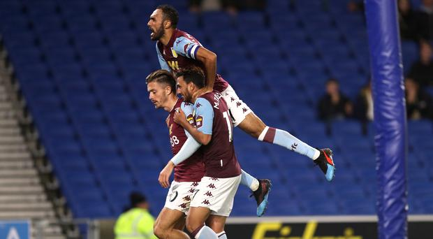 Aston Villa's Jack Grealish (left) celebrates scoring his side's third goal of the game with team-mates during the Carabao Cup, Third Round match at the AMEX Stadium, Brighton.