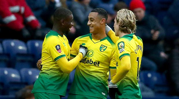 Adam Idah, centre, helped fired Norwich into the fourth round of the FA Cup (Dave Thompson/PA)