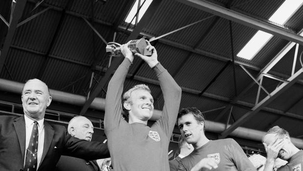 England captain Bobby Moore lifts the Jules Rimet trophy after the side won the 1966 World Cup (PA)