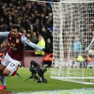 Aston Villa's Trezeguet celebrates scoring his side's second goal of the game against Leicester (Nick Potts/PA)