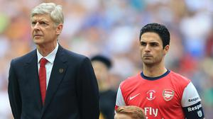 Arsene Wenger (left) and Mikel Arteta (right) won the FA Cup as manager and captain of Arsenal in 2014. (Nick Potts/PA)