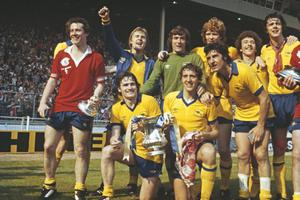 Local heroes: Pat Rice and Sammy Nelson hold the FA Cup as Arsenal with Pat Jennings in goal beat Man United 3-2 in the 1979 final