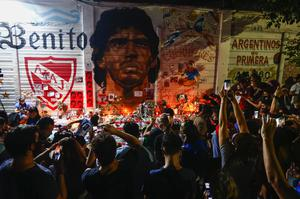 Fans hold a vigil for Maradona outside the stadium of Argentinos Juniors, the club where he started his career (Marcos Brindicci/AP)