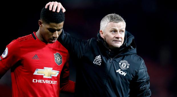 Ole Gunnar Solskjaer, right, says Manchester United will do all they can to get Marcus Rashford fit to face Liverpool (Martin Rickett/PA)