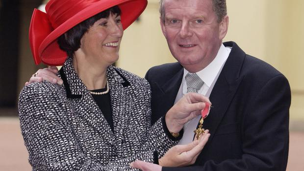 Motson with his wife Annie, receiving an OBE in 2001