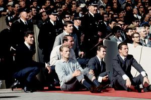 Hunter (top) watches the 1966 World Cup final from the sidelines (PA)